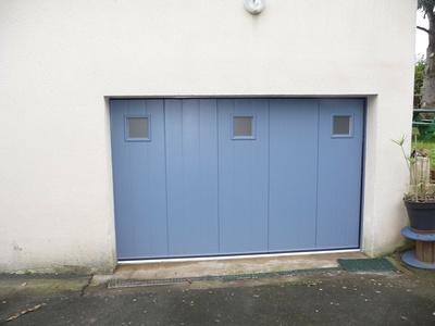 Changement d''une porte de garage en aluminium