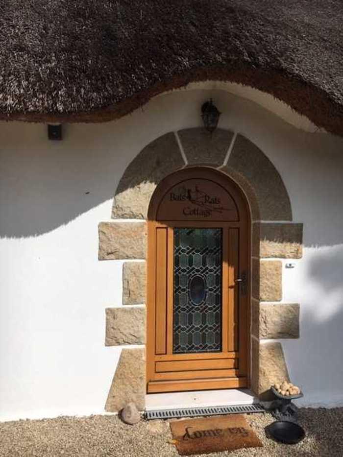 Menuiseries mixtes et menuiserie bois sur maison au toit de chaume img5815
