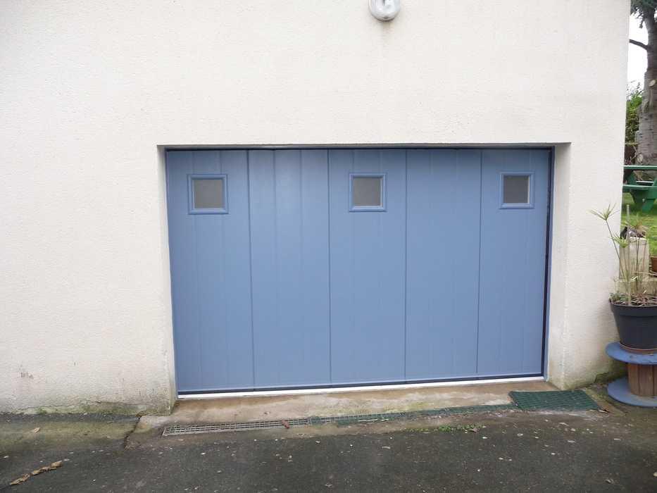 Changement d''une porte de garage en aluminium 0