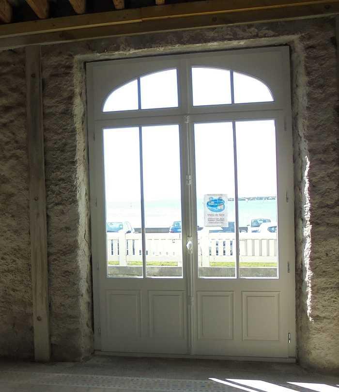 Rénovation fenêtres bois cintrées - ouverture à la française 31
